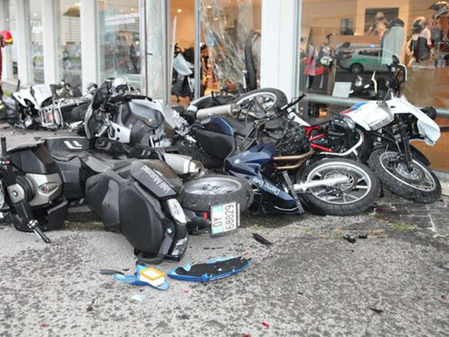 Lamborghini Murcielago crashes into a BMW bikes' dealership with a huge loss