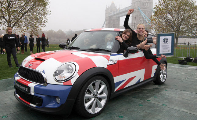 A New Guinness World record 28 People in a Mini Cooper