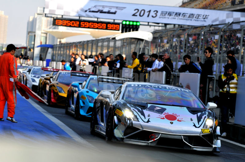 Teams Line up in the Pit Lane Just Before the Race