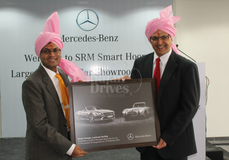Eberhard Kern MD&CEO Mercedes-Benz India handing over the Dealer Memento to Neeraj Agarwal Managing Director SRM Smart Hoop