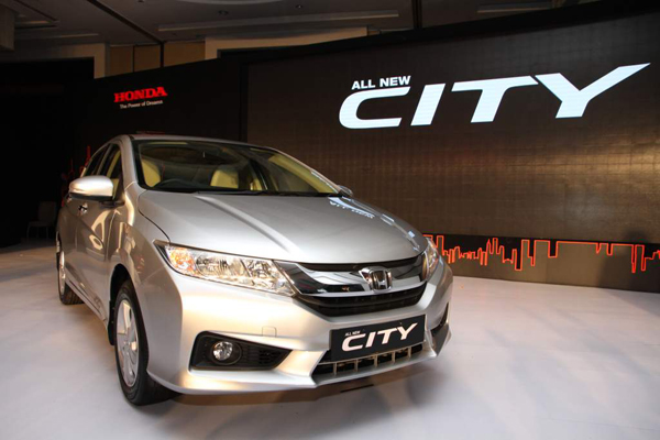 2014 Honda City. Coming To The Exteriors Of The Top Two Models, The Car  Offer Fog Lamps, Alloy Wheels And Rear Seat Power Outlets.