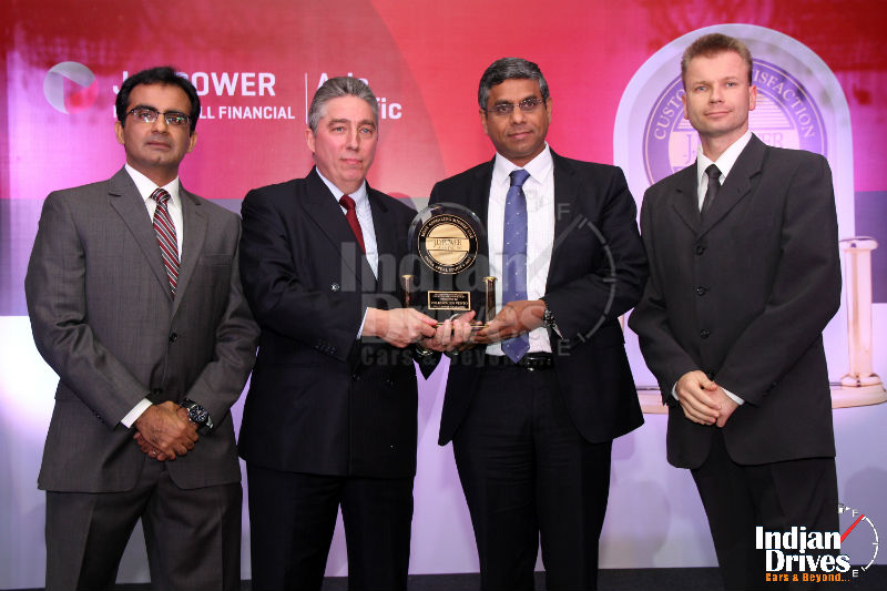 Mahesh Kodumudi Volkswagen Group India Chief Representative & Stephan Neubert Chief General Manager Quality Assurance Volkswagen India receiving the trophy