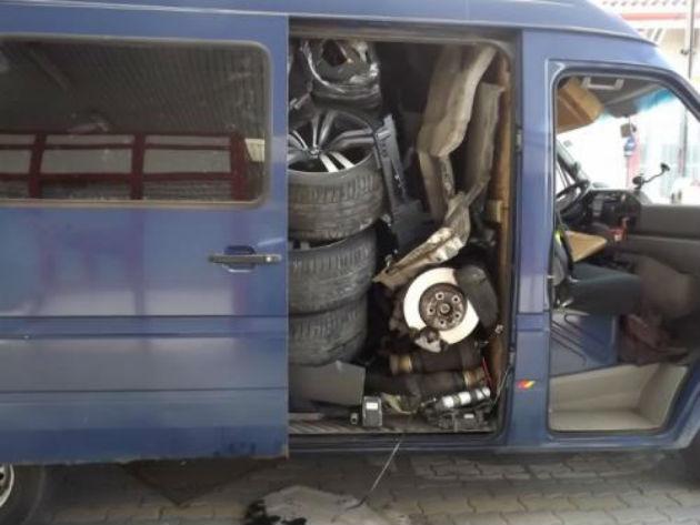 BMW X6 inside a Volkswagen LT van