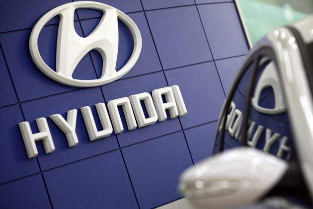 File picture shows the Hyundai logo next to the company's Sonata sedan at a dealership in Seoul